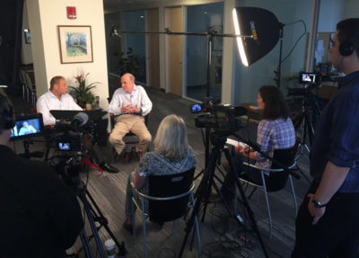 View of a thought leader discussion from behind the camera.rs.